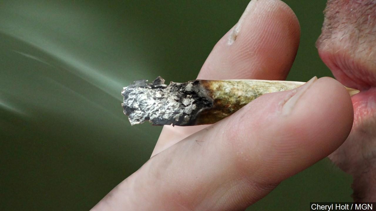 Person smoking Marijuana.