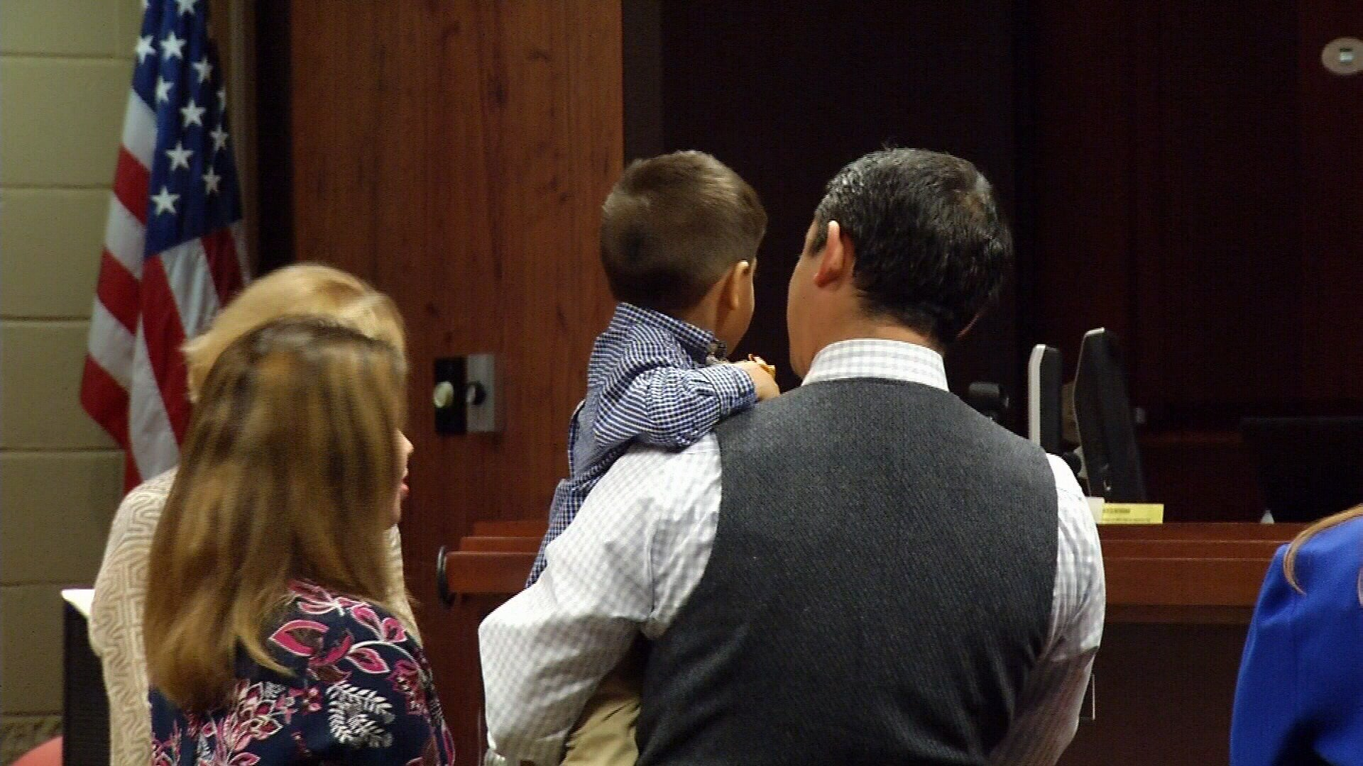 FILE PHOTO: One of several adoptive families at County Court 5. Photo Take: November 10, 2016.