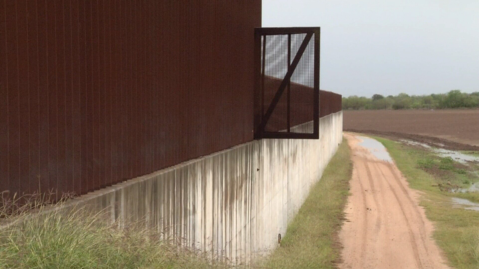 The border wall in Progreso has openings to allow landowners to access private property, and ends a few miles out from the checkpoint.