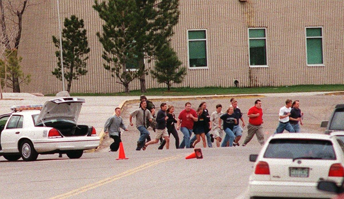 In this image taken from video, a group of freed students and faculty run from Columbine High School in Littleton, Colo., after two students swept through their school with guns and explosives. (Hal Stoelzle/AP)