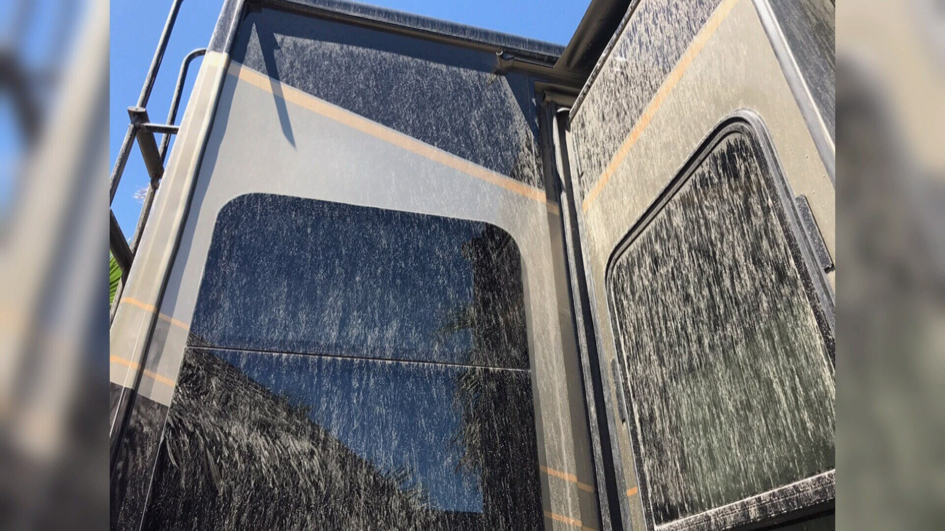 A look at a sand-covered RV.