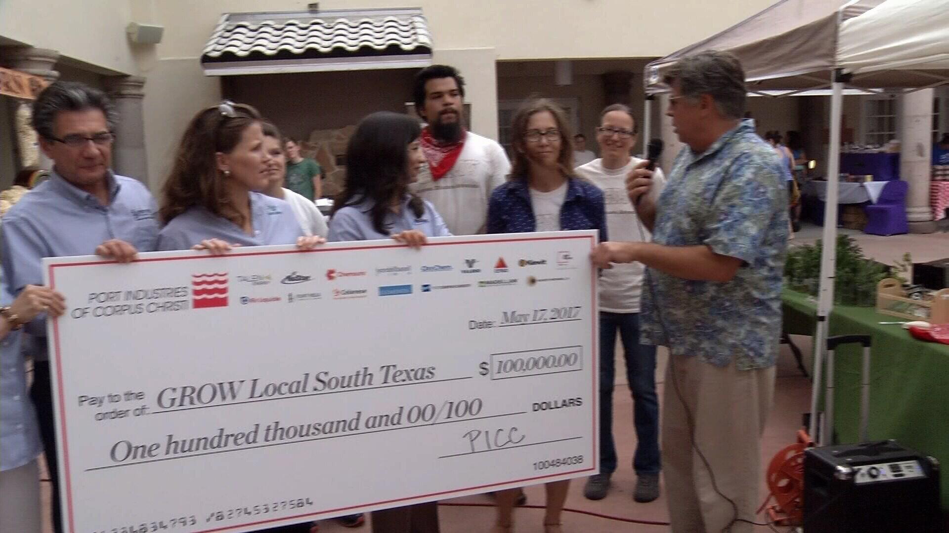 Port Industries Executive Director Bob Paulison presents a $100,000 check to Grow Local South Texas. (KRIS)