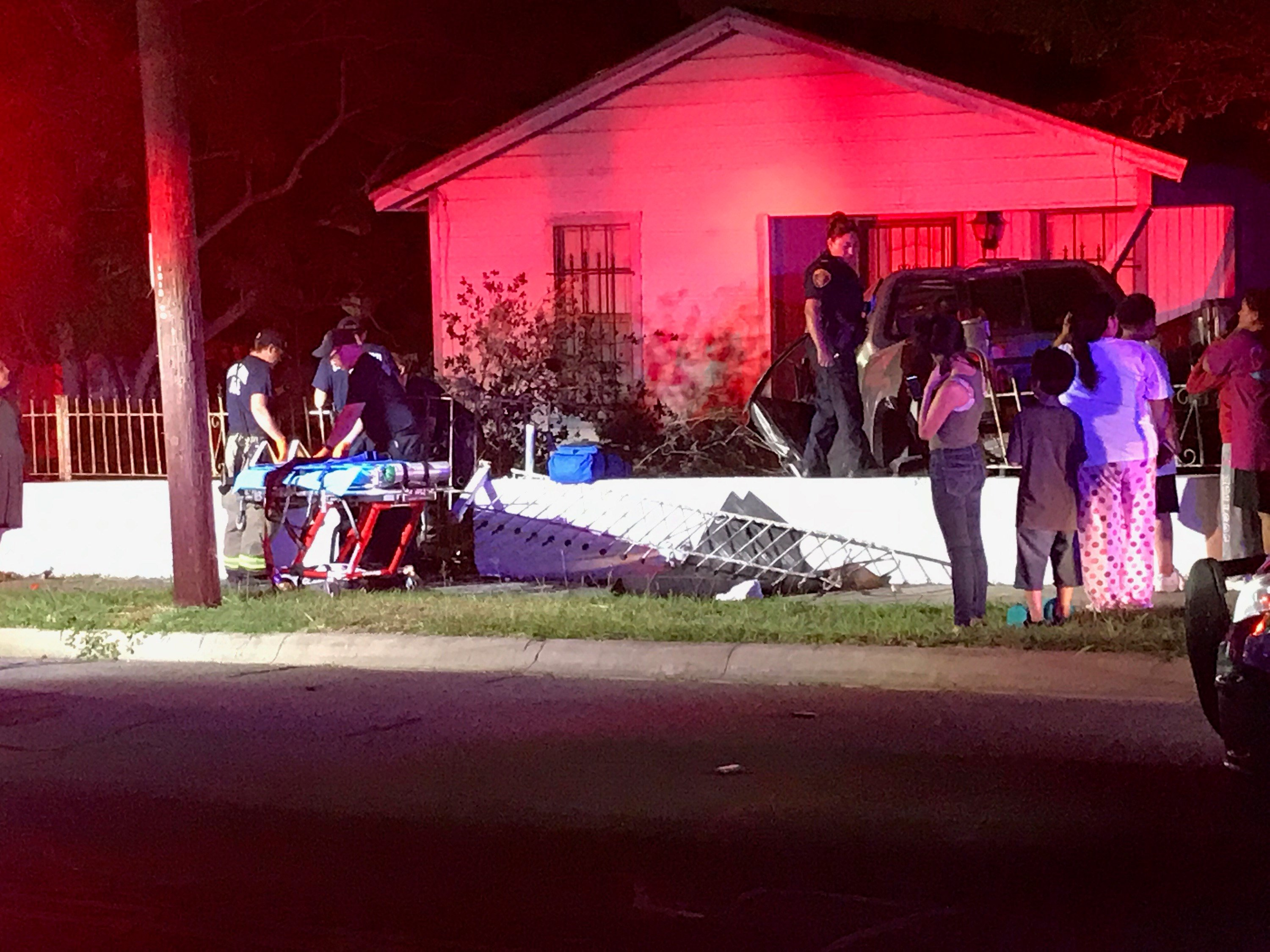 Crews reported that a vehicle crashed into a telephone pole and then a nearby front yard.