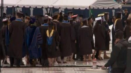 Dozens of Notre Dame graduates walk out of the commencement ceremony