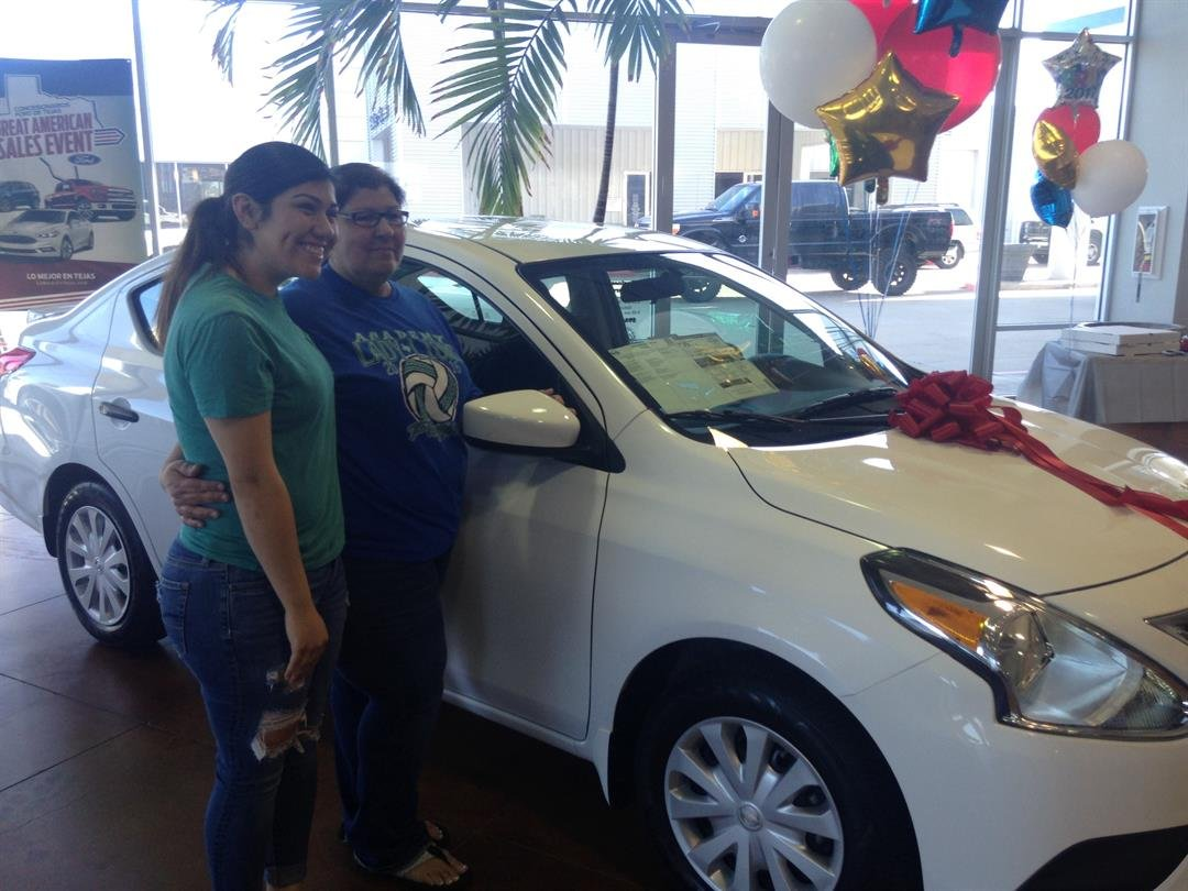 The lucky winners of SAMES Ford's perfect attendance raffle, seen with their grand prize.