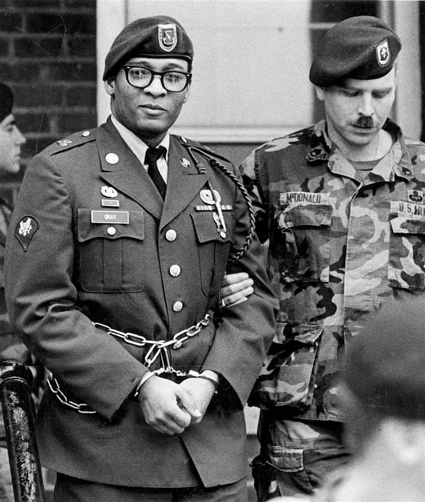 Ronald Gray leaves a courtroom escorted by military police at Ft. Bragg, North Carolina, on April 6, 1988. Photo courtesy Marcus Castro/AP File
