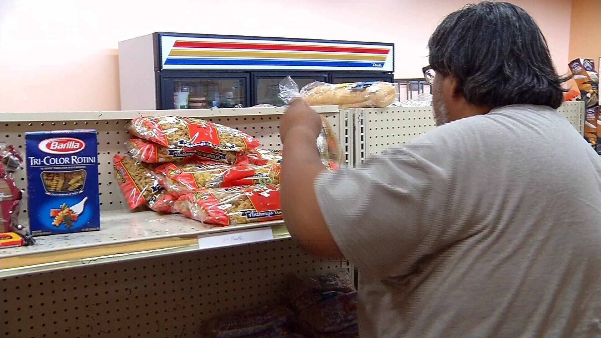 A man gets food at the Food Bank of Corpus Christi.