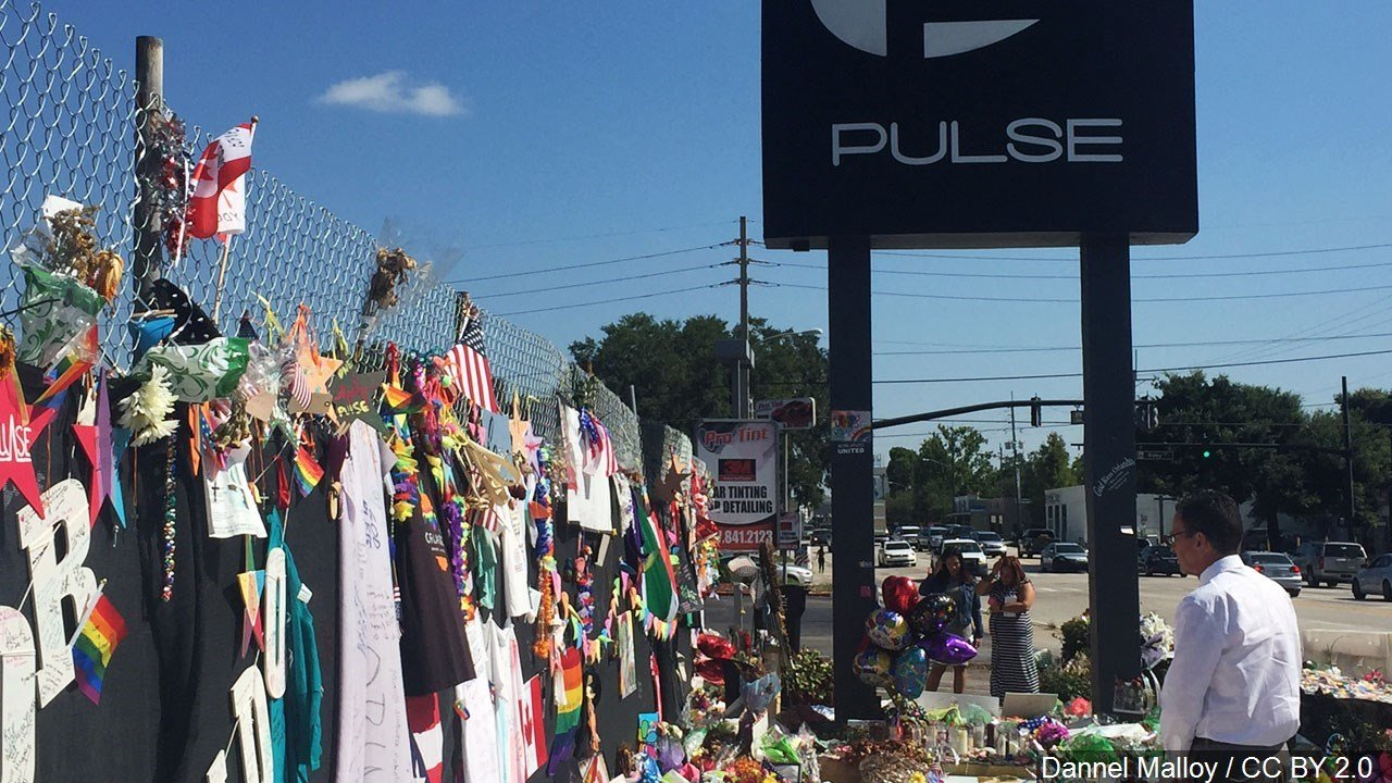 Scores gather outside Pulse to honor massacre victims