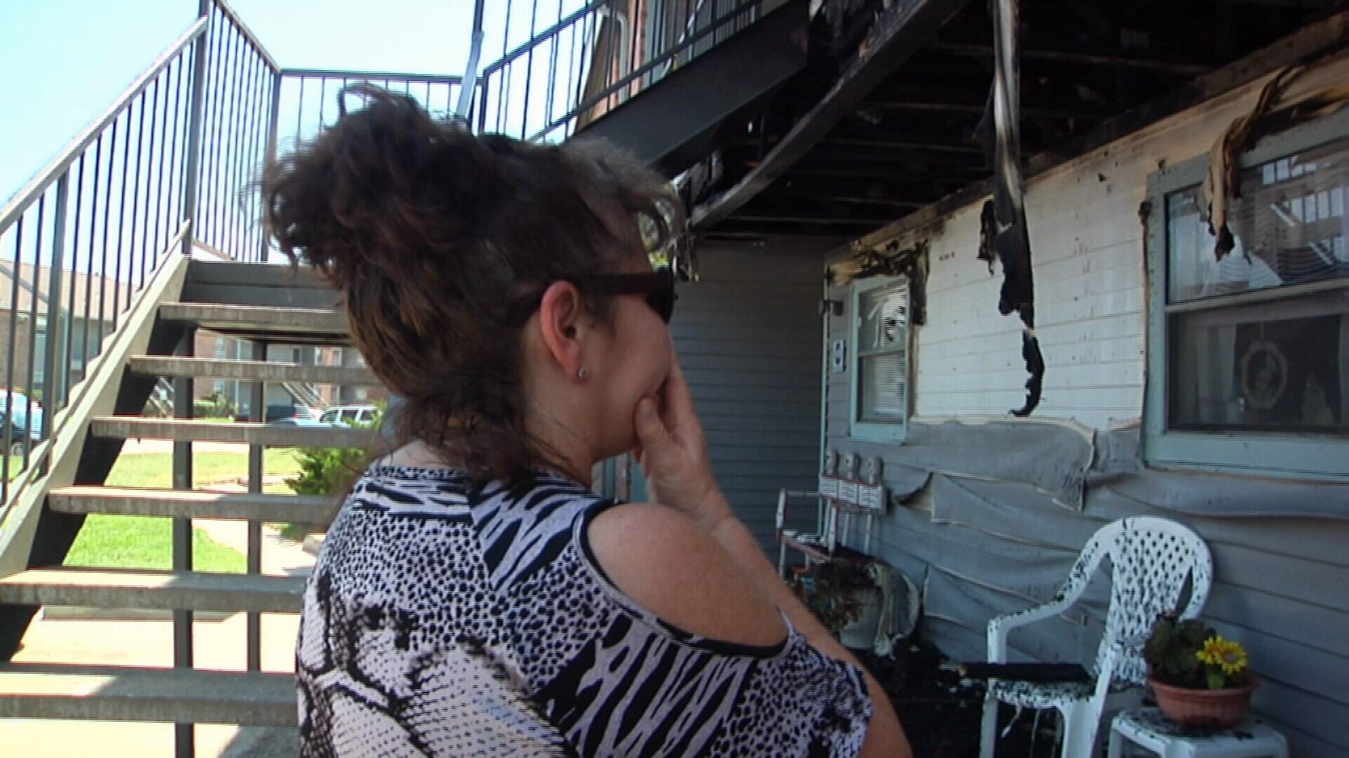Cindi Bonifer looks in shock at her apartment. (KRIS)