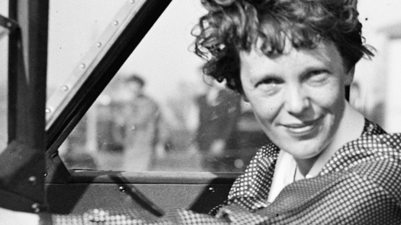 PHOTO: Amelia Earhart in her airplane, Photo Date: 1936