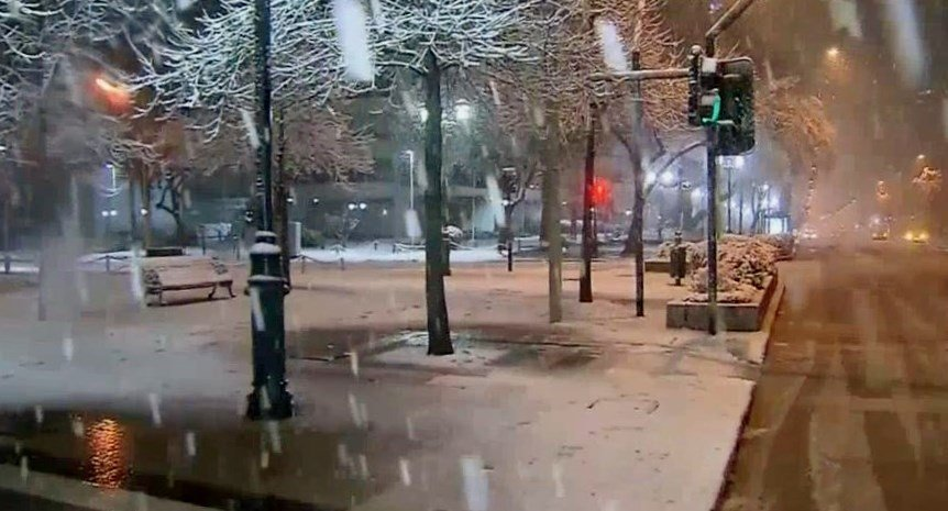 Chilean capital shakes off rare snow storm