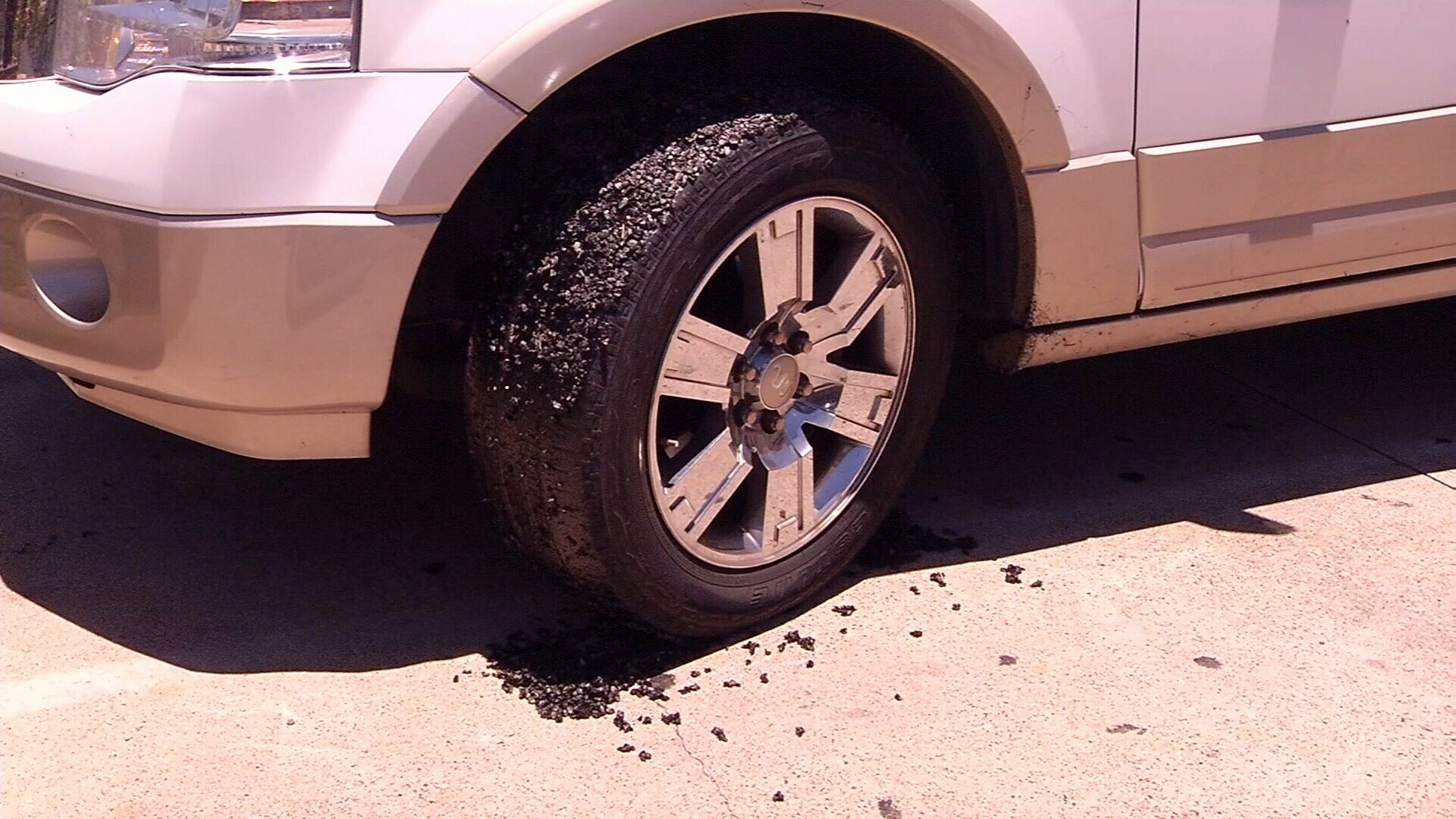 Drivers say tar flew onto their cars and clogged their wheels when they were driving through a street repair project.