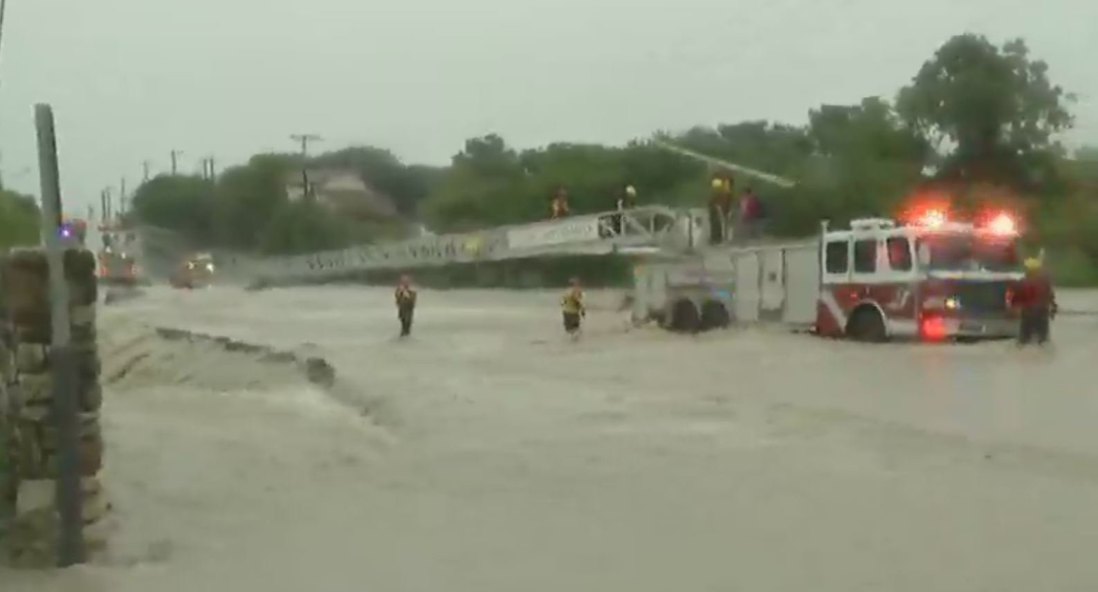 Texas man stuck on top of SUV in raging waters, rescued later