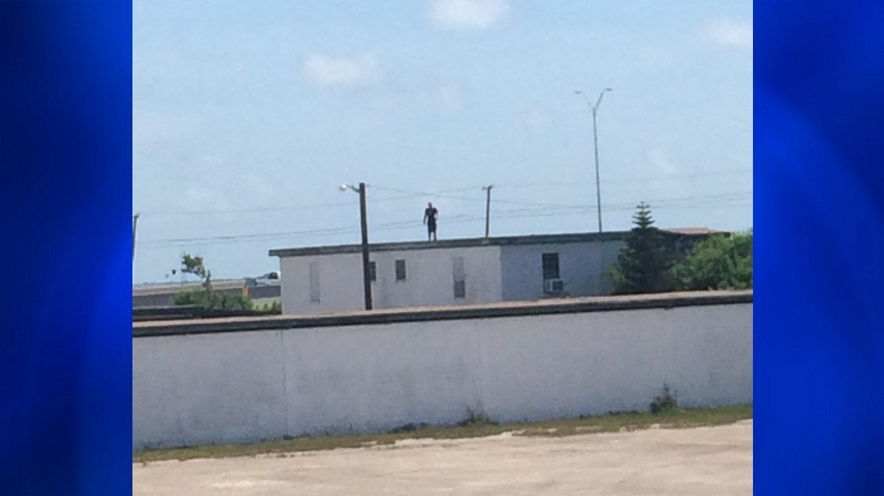 A suspect evaded police after being cornered on a rooftop.