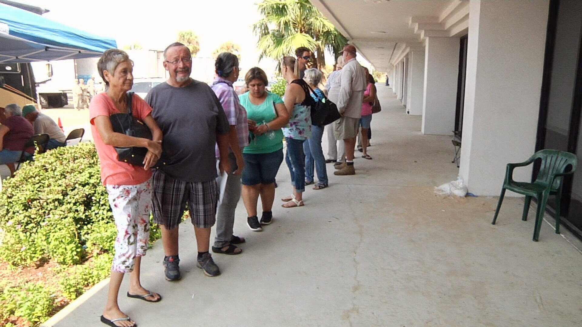 Dozens of storm victims wait outside the FEMA disaster recovery center in Ingleside.
