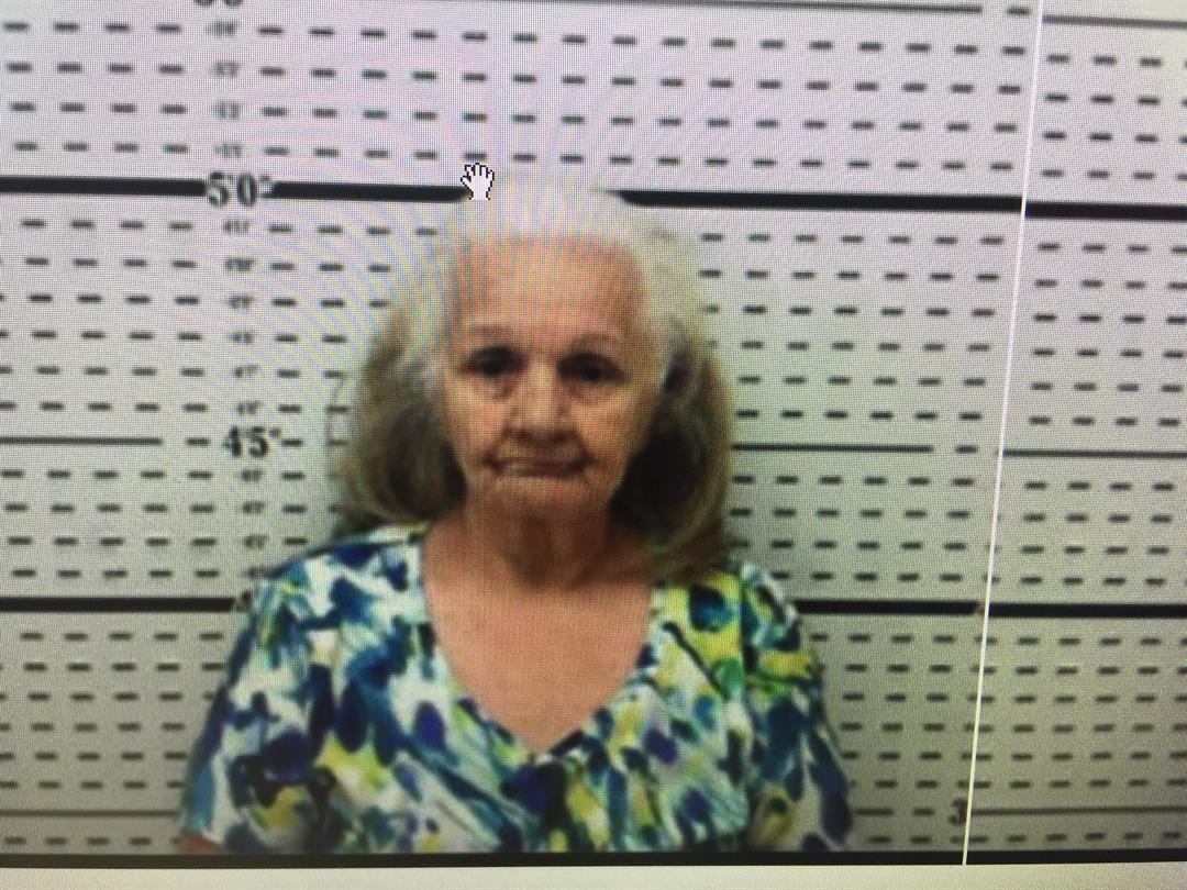Andrea Flores, 73, was found by officers weighing and packaging cocaine inside her home.