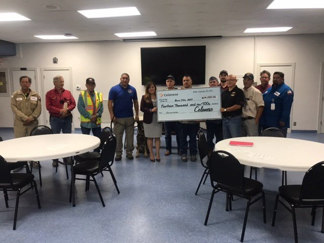 "Employees at Celanese presented the group ""Burn Pits 360"" with a $14,000 check."