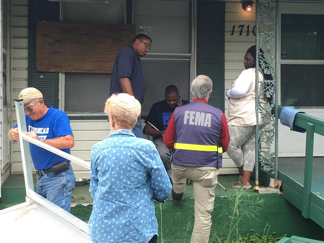 Roger and Betty Horan assemble a donated handicap ramp outside Dwayne Porter's home while FEMA representatives take a second look at his denied claim. (KRIS 6 News)