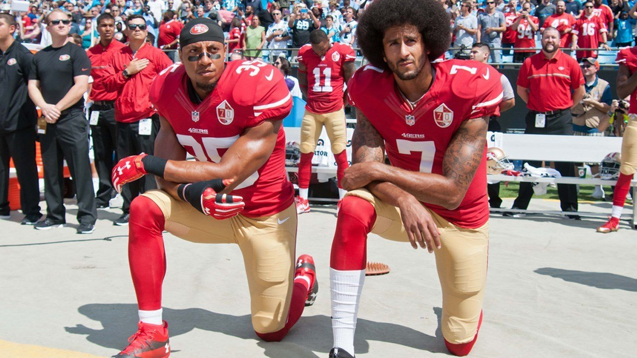 PHOTO: San Francisco 49ers Eric Reid and Colin Kaepernick take a knee during the National Anthem prior to their game against the Carolina Panthers in Charlotte North Carolina, Photo Date: 9/18/16 (Photo: Ed Clemente / MGN)