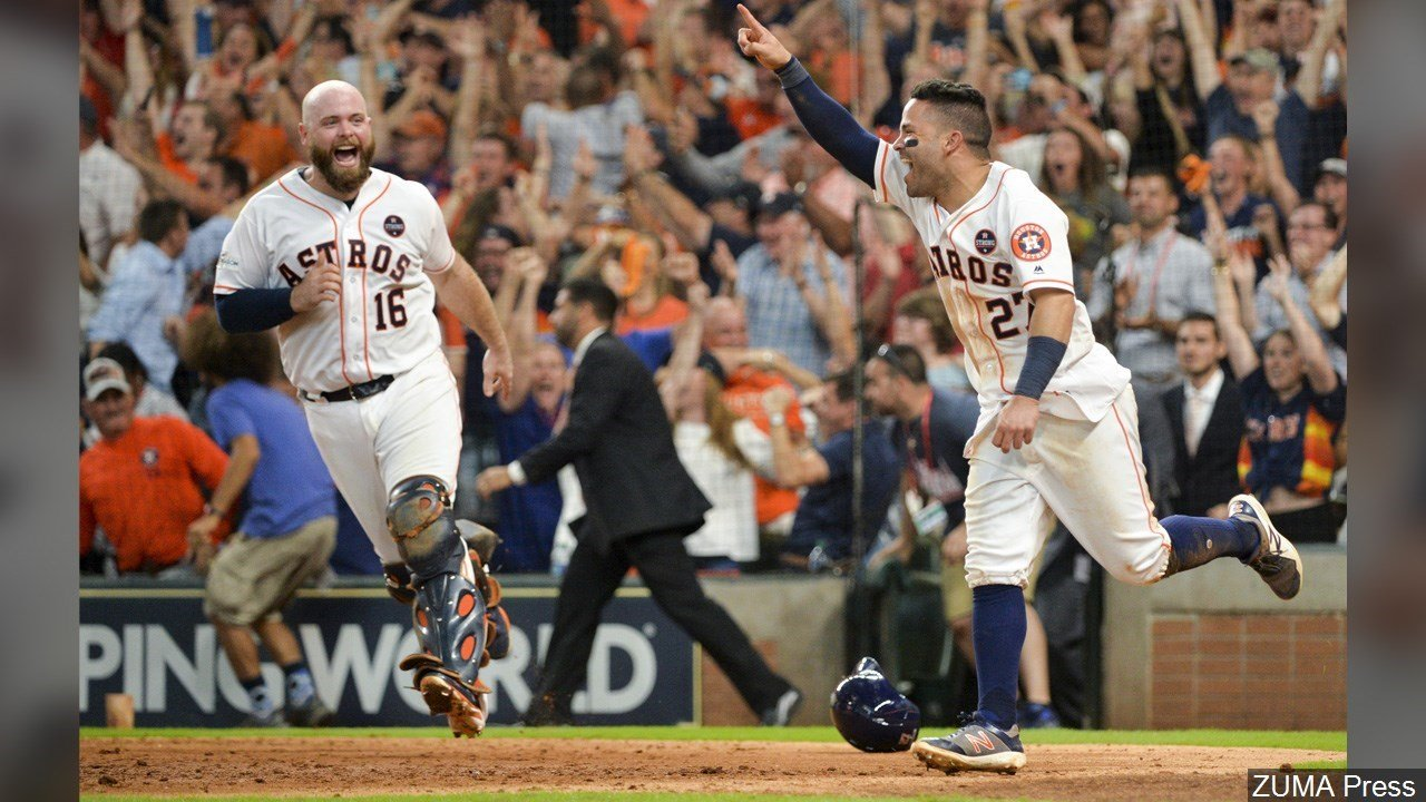 PHOTO: Jose Altuve - Houston Astros Second baseman celebrates after scoring the game-winning run against the New York Yankees during the ninth inning in Game 2 of the American League Championship Series, Photo Date: 10/14/17