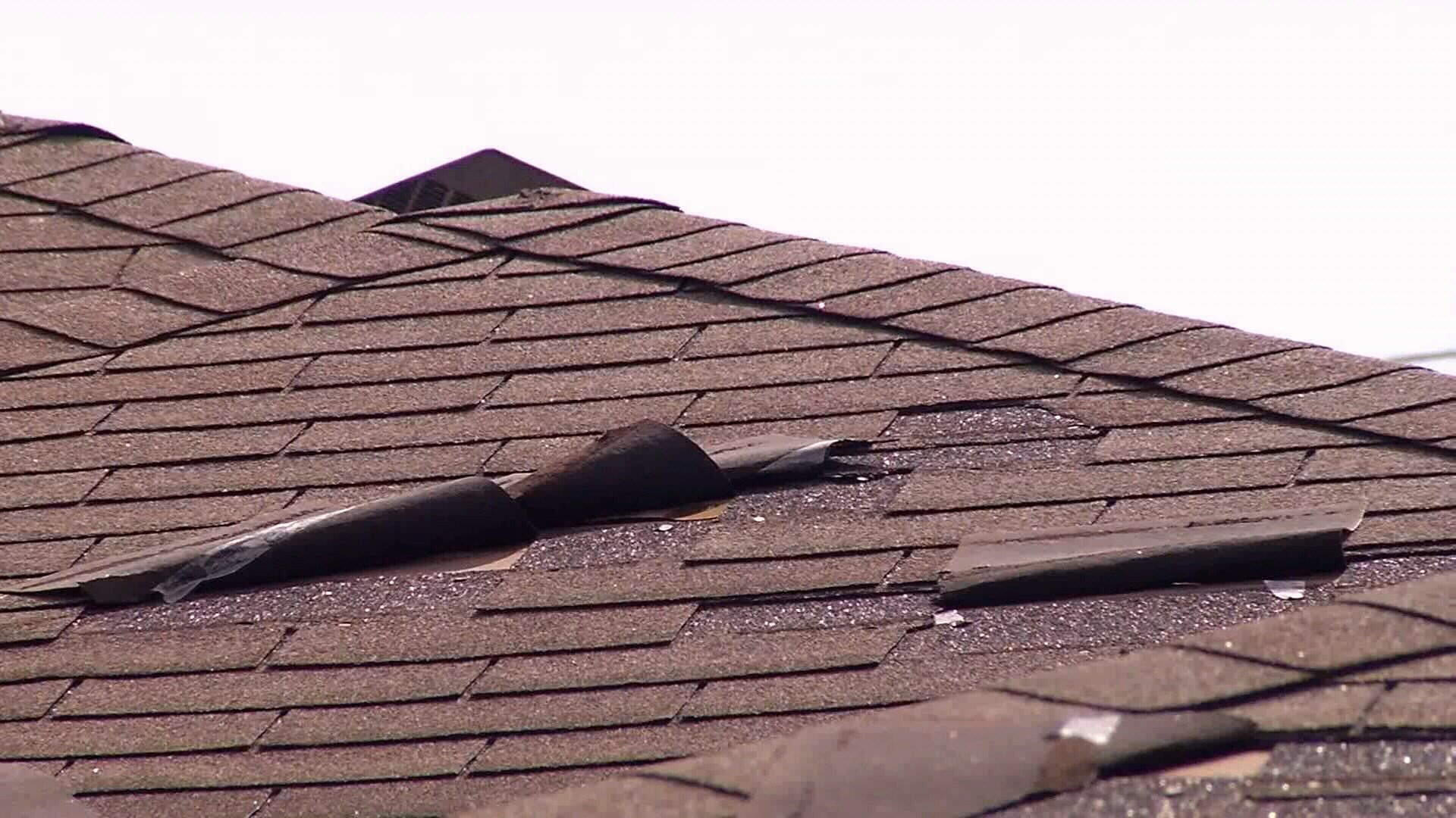 Peeled roof shingles are just some of the damage that concerns homeowners in two new Southside subdivisions. (KRIS 6 News)