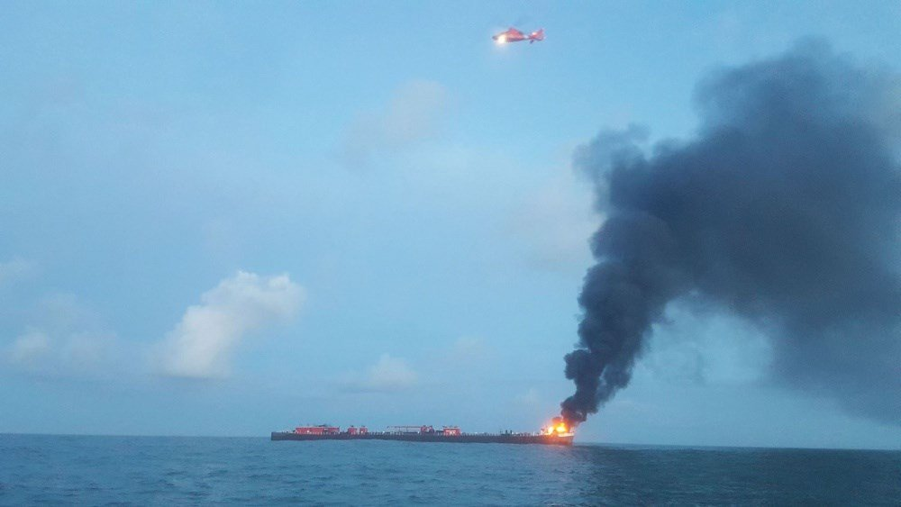 Two missing after crude barge catches fire in Texas