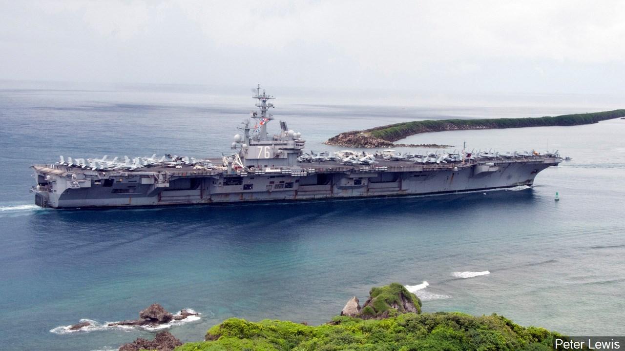 PHOTO: The aircraft carrier USS Ronald Reagan (CVN 76) enters Apra Harbor, Guam, Photo Date: 8/21/11