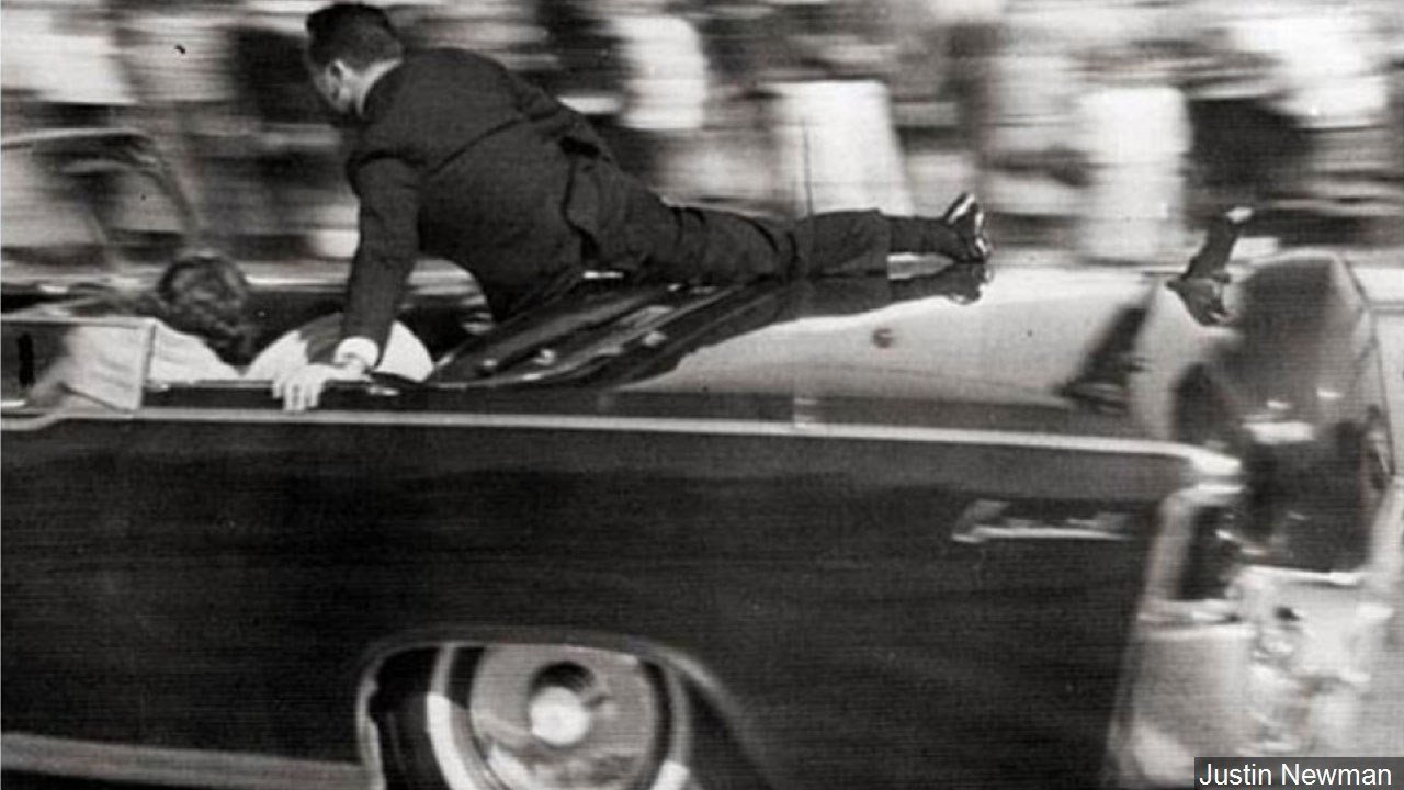 PHOTO: Secret Service agent Clinton Hill shielding the occupants of President Kennedy's limousine, Photo Date: 11/22/1963