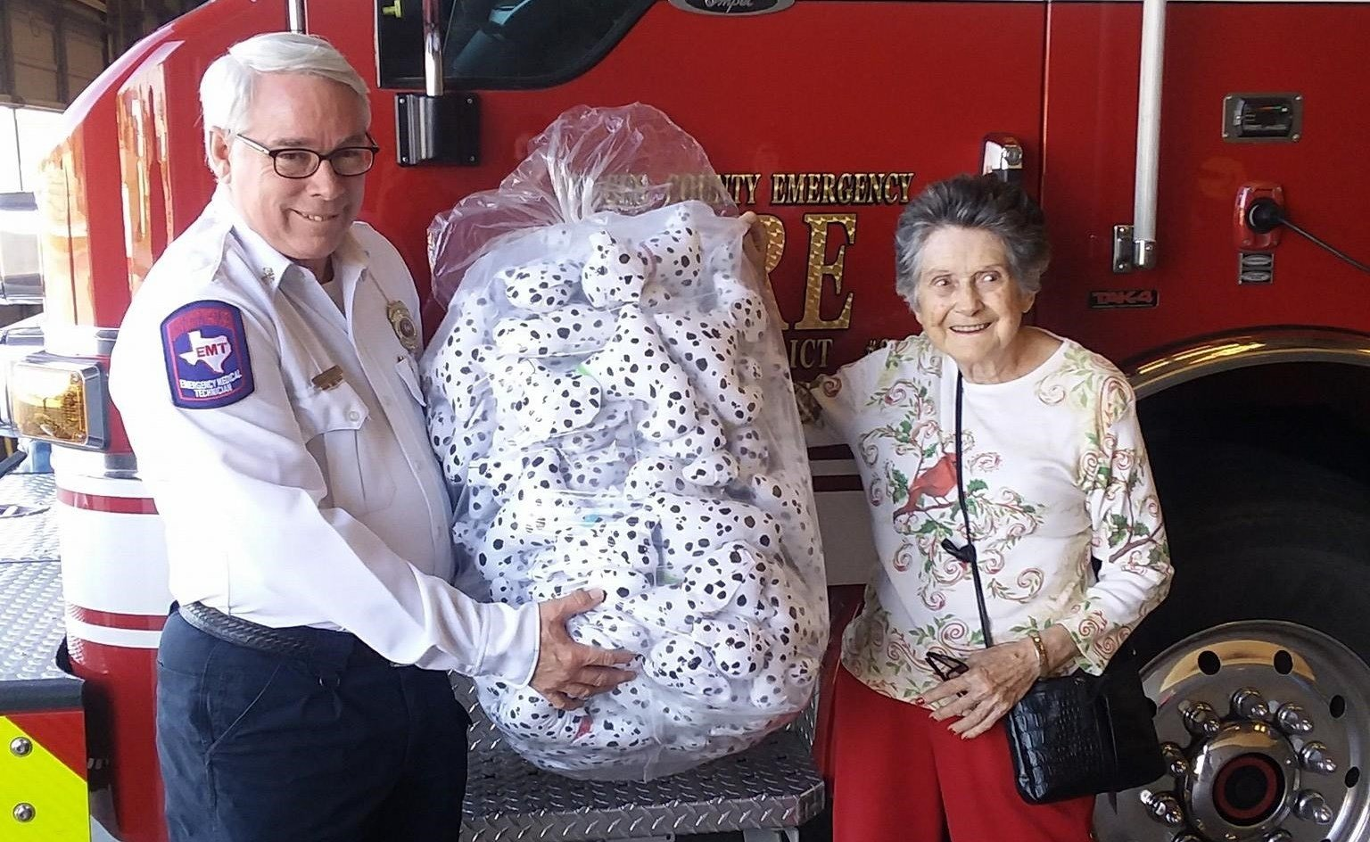 Photo: Mrs. Leota Gaines donating 101 handmade Dalmatians to the Nueces County ESD #2. (Courtesy: Nueces County ESD #2)