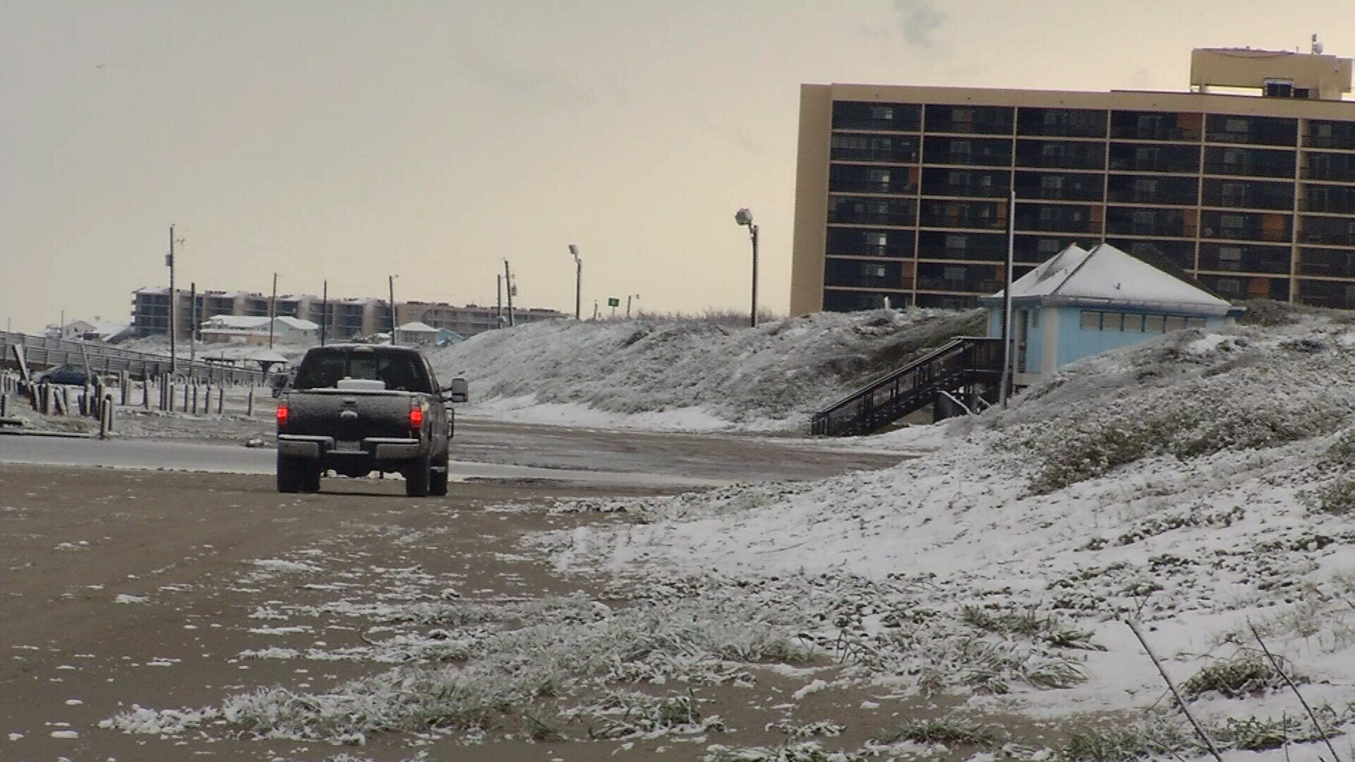 Snow covered portions of the beach in Port Aransas.
