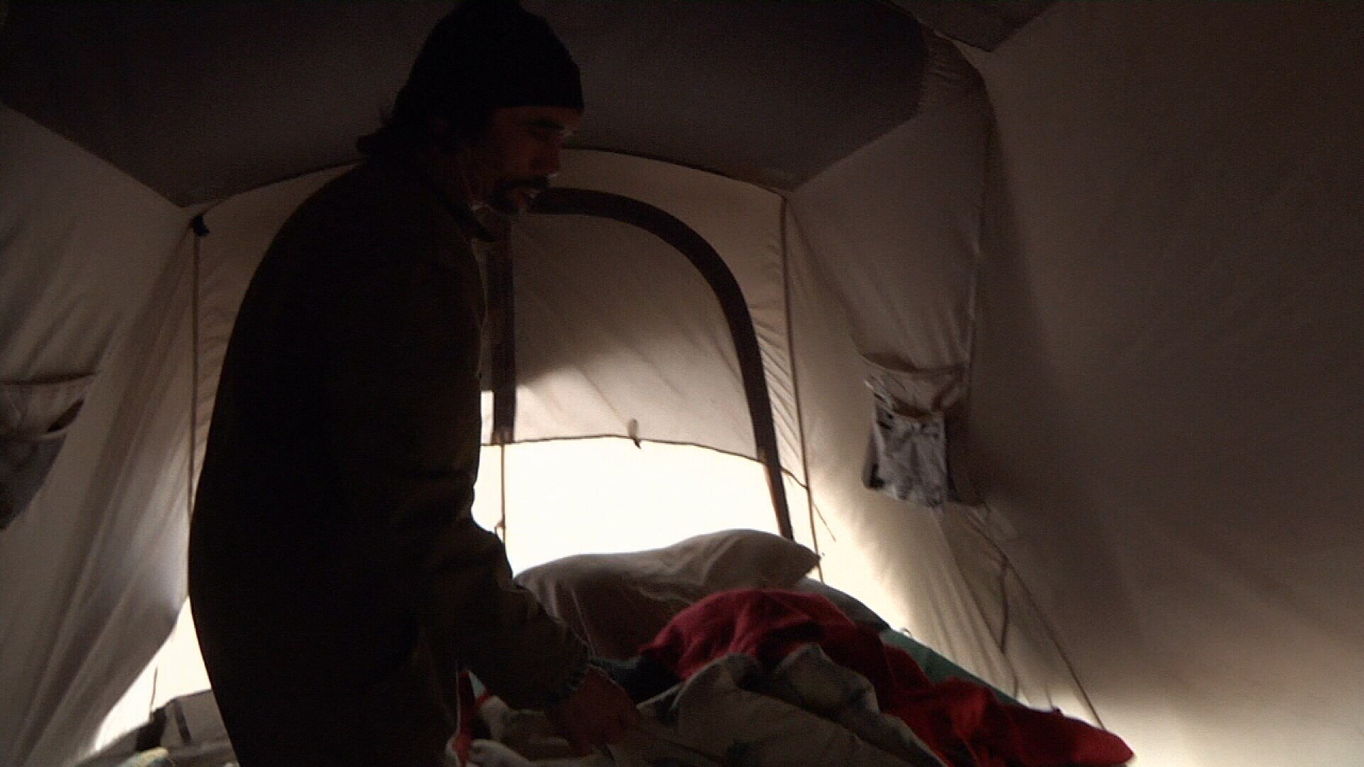 Some displaced storm victims and volunteers helping them are still living in tents and prepare for temperatures to drop.