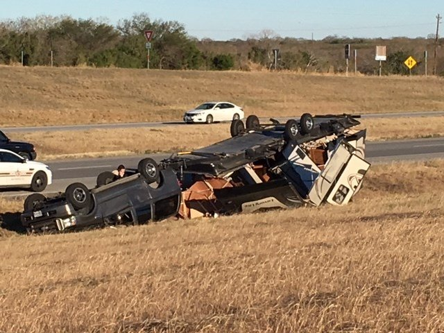 A vehicle towing an RV could be seen upside down on the IH37 roadside.