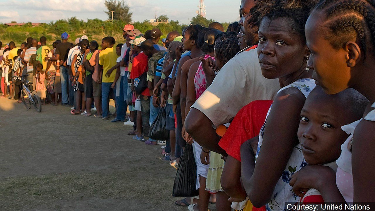 Haitians displaced by the massive earthquake that devastated their country form a long line to wait for UN-distributed meals. Photo by Logan Abassi