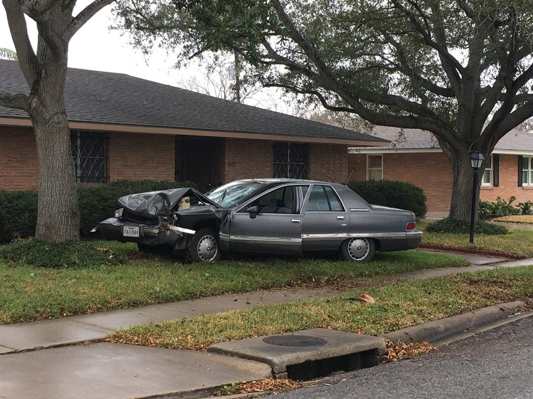 Police said a driver collided with a tree in the yard of a nearby residence after losing control of his vehicle during an argument on the phone.