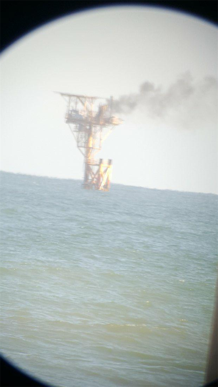 A platform offshore from Padre Island was seen with a fire on board its deck from the nearby shoreline.