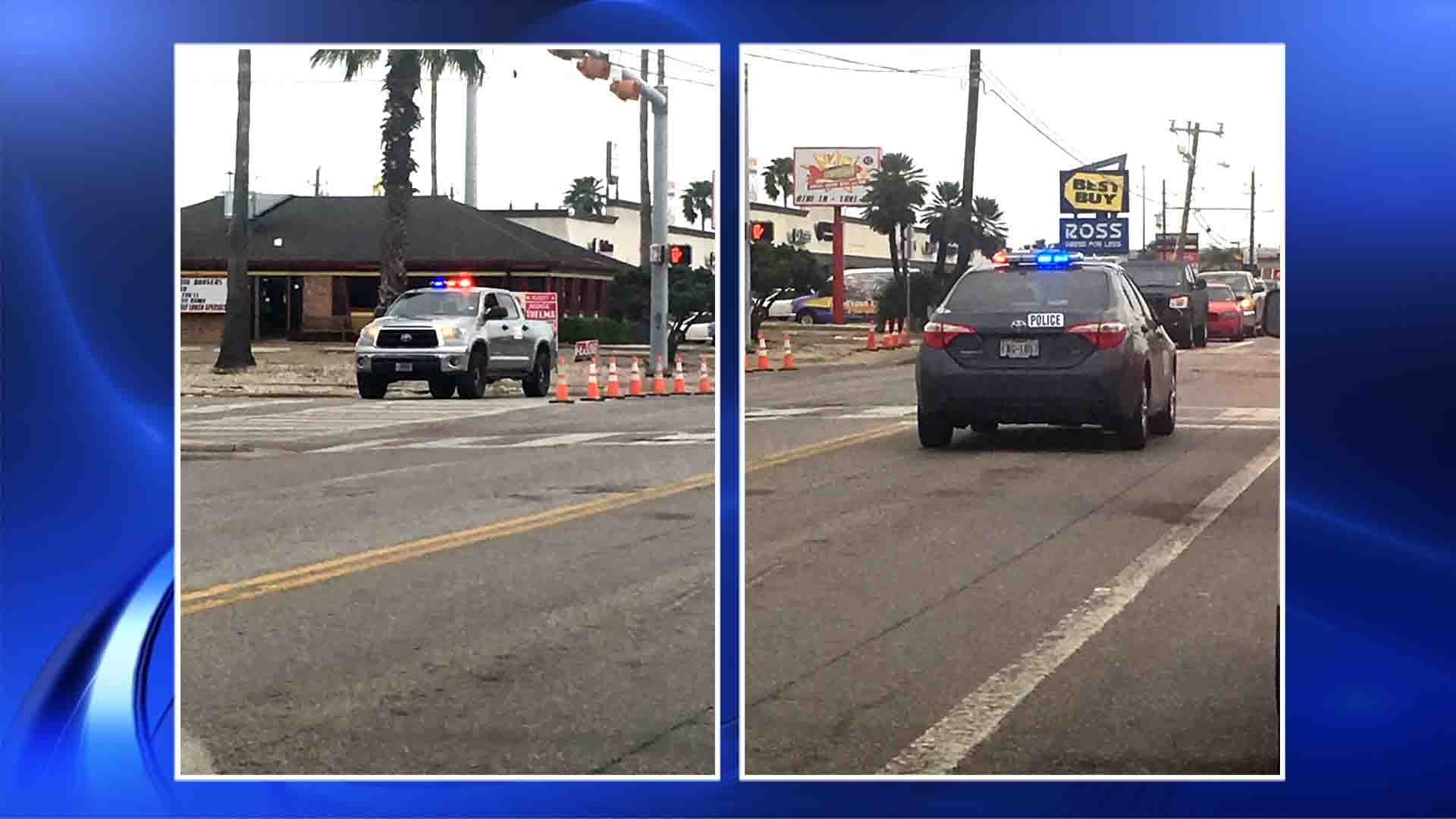 Two cars with flashing lights were spotted in the Everhart Road and Corona Drive intersection Friday morning.