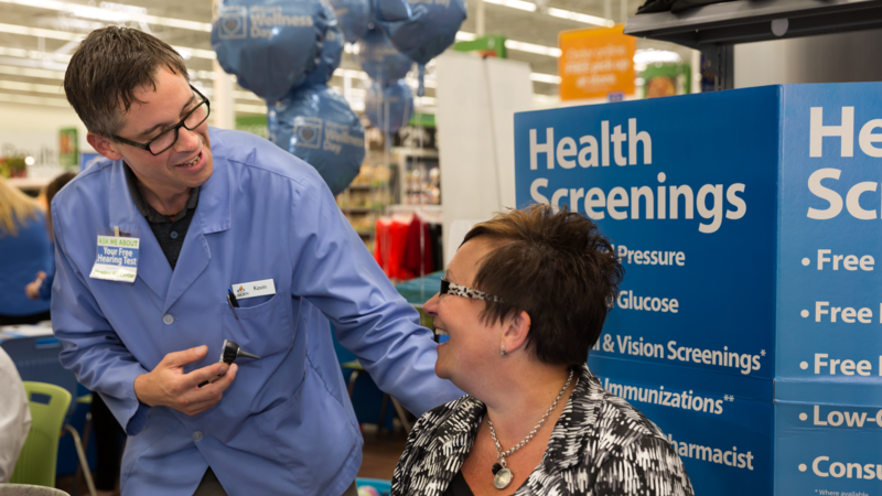 A Walmart employee meets with a customer during Walmart Wellness Day. Photo: Walmart