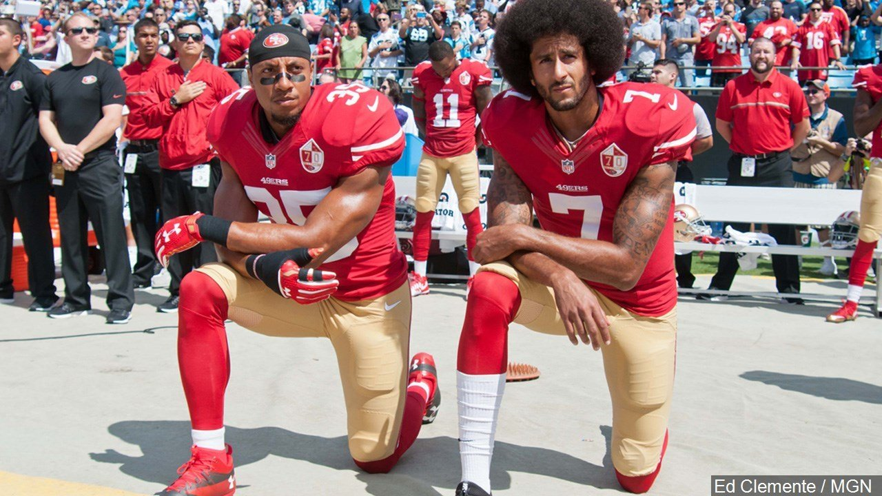 PHOTO: San Francisco 49ers Eric Reid and Colin Kaepernick take a knee during the National Anthem prior to their game against the Carolina Panthers in Charlotte North Carolina