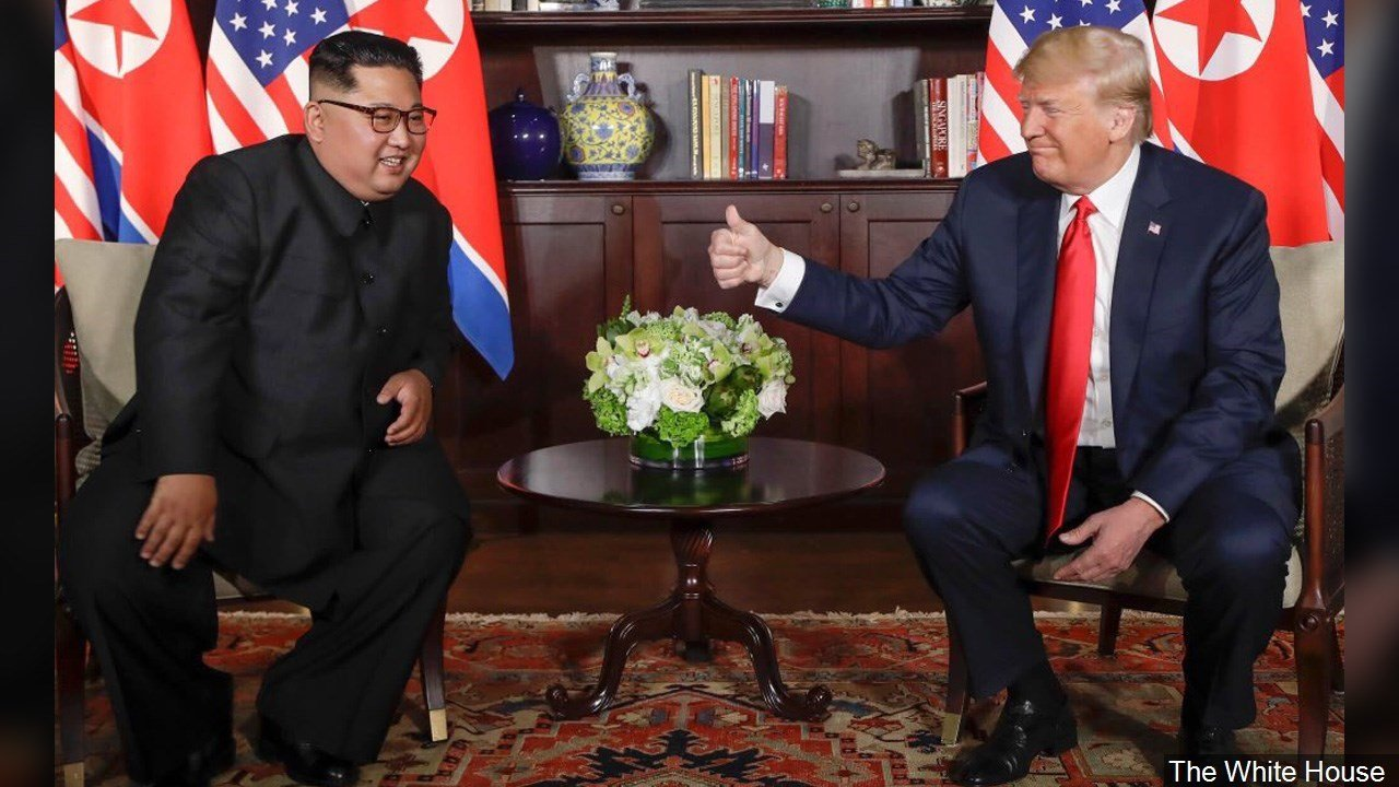 PHOTO: North Korean Leader Kim Jong-un and US President Donald Trump meet in Singapore, Photo Date: 6/12/18