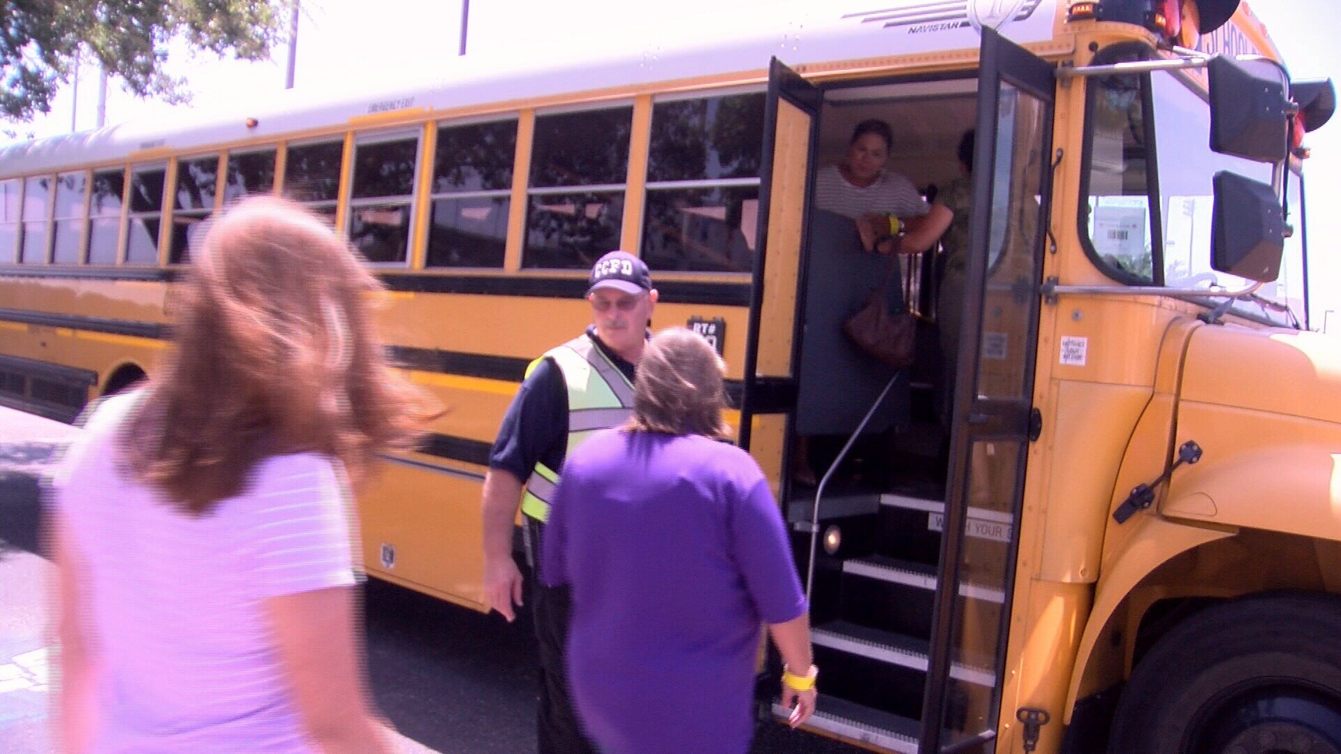 Several residents load a CCISD bus during Friday afternoon's emergency evacuation exercise. (KRIS)