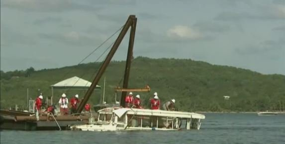 Officials raise duck boat that sank in storm, killing 17