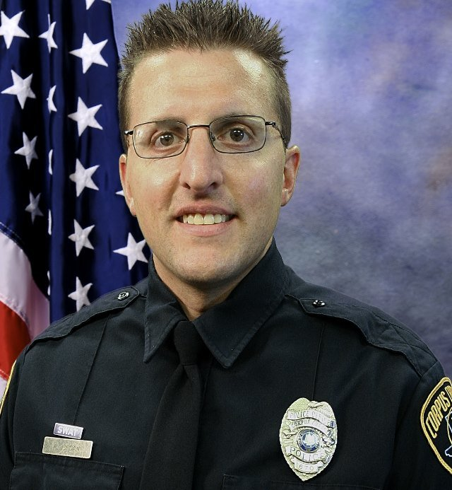 Officer Andrew Jordan (4-year veteran) received a gunshot wound to his upper leg and one to his forearm.