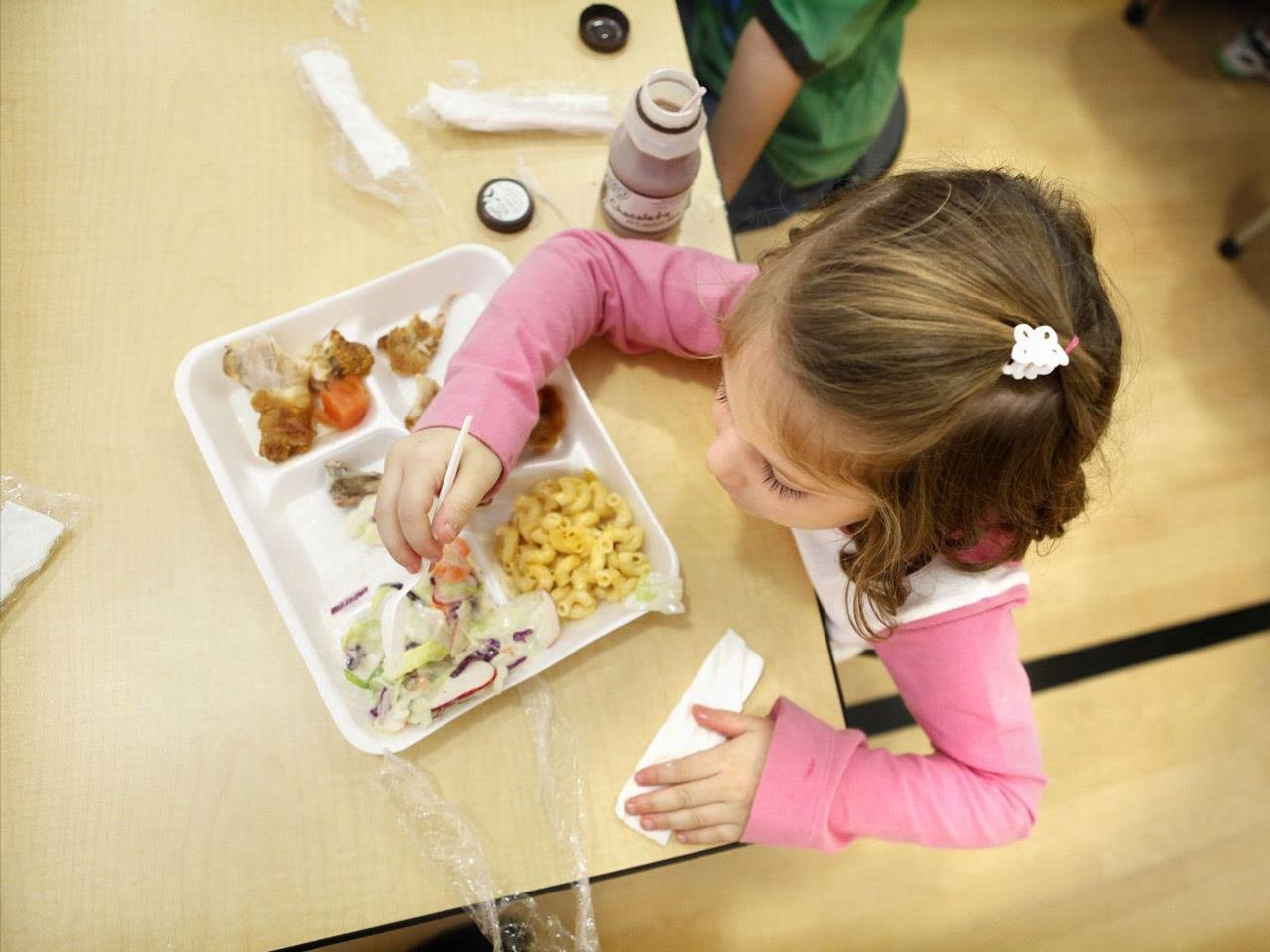 Girl eating school lunch (MGN)