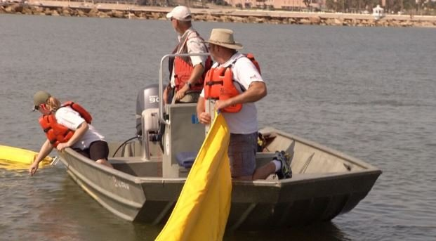 A boom was laid out Friday to contain an imaginary oil spill in the downtown marina.