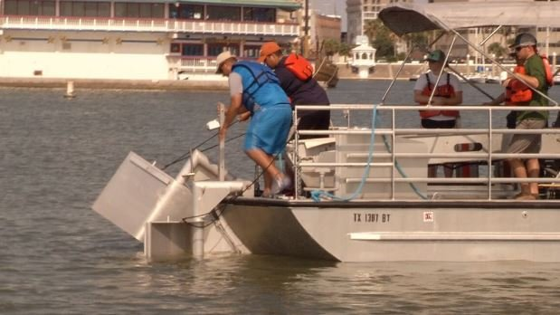 A skimmer was launched to suck up the imaginary oil as part of a training exercise Friday in the downtown marina.