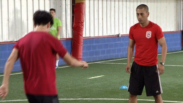 Corpus Christi FC head coach Sammy Girlado (R) trains with his players. (